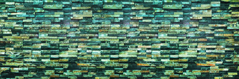 panorama of dark modern brick wall for background and design Stock Image