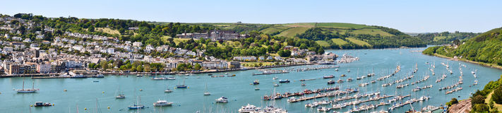 Panorama of Dartmouth and harbour. Panorama of Dartmouth & harbour with the Britannia Royal Naval College in the background stock photo