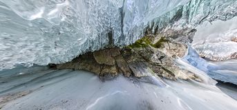 Panorama dawn in an ice cave with icicles on Baikal, Olkhon Stock Photos