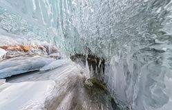 Panorama dawn in an ice cave with icicles on Baikal, Olkhon.  royalty free stock image