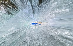 Panorama dawn in an ice cave with icicles on Baikal, Olkhon.  stock photo