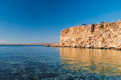 Panorama de la plage au récif Photographie stock