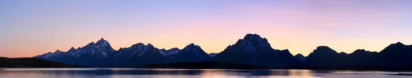 Panorama de la vue de coucher du soleil des montagnes grandes de Teton Image libre de droits