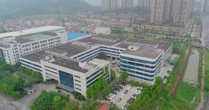 Panorama de las cercanías de Gunzhou, opinión aérea de las casas y de las fábricas metrajes