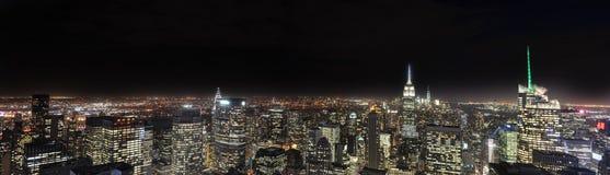 Panorama de New York City Nightscape imagens de stock royalty free