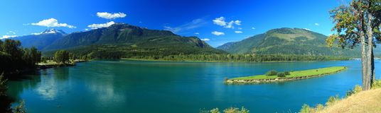 Columbia River at Revelstoke, British Columbia, Canada. Panorama of the deep blue waters of the Columbia River at Revelstoke in central British Columbia with the Royalty Free Stock Photography