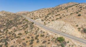 Panorama del camino vacío del desierto Foto de archivo libre de regalías