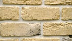 Panorama del mattone decorativo giallo per la casa Fondo della muratura Figura blocco video d archivio