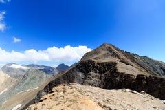 Panorama della montagna con la sommità Kreuzspitze, alpi di Hohe Tauern, Austria Immagini Stock