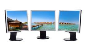 Panorama delle Maldive nei monitor del computer Immagine Stock