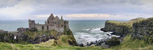 Dunluce Castle. A panorama with details from the famous Dunluce Castle back lit - a landmark from County Antrim, Northern Ireland Royalty Free Stock Photos