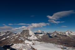 Panorama di inverno del supporto il Cervino coperto di nuvole, cantone del Valais Immagini Stock Libere da Diritti