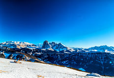 Panorama of the Dolomites with chalet,  snow-capped peaks and co. Panorama of the Dolomites with chalet, snow-capped peaks and conifers Stock Images