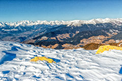 Panorama of the Dolomites with snow-capped peaks. And conifers Royalty Free Stock Images
