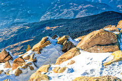 Panorama of the Dolomites with snow-capped peaks. And conifers Royalty Free Stock Photo