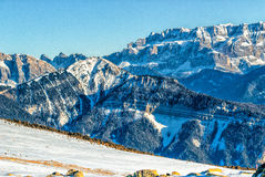 Panorama of the Dolomites with snow-capped peaks. And conifers Stock Images