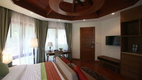 Panorama of double bed hotel room. At background of windows in curtains stock video