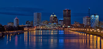 Panorama of Downtown Rochester New York at night. A nighttime panoramic view of downtown Rochester, New York on the Genesee River Stock Photography