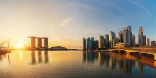 Panorama of Downtown Singapore city in Marina Bay area and reflection. Financial district and skyscraper buildings at sunset.  royalty free stock photos