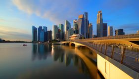 Panorama of Downtown Singapore city in Marina Bay area and reflection. Financial district and skyscraper buildings at sunset.  royalty free stock image