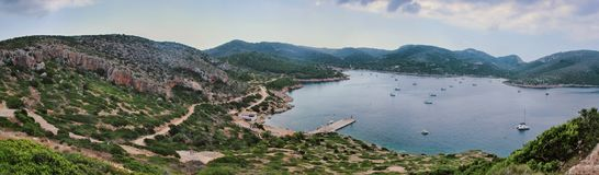 Panorama of dragon island. Near mallorca. U can see mountains around the center of the island where boats are sailing royalty free stock image