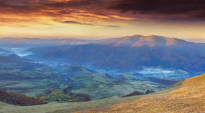 Panorama of the dramatic autumn sunset in mountain Royalty Free Stock Photography