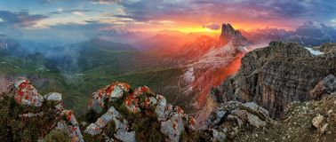 Panorama dramatic sunset in dolomites alp mountain from peak Nuvolau royalty free stock photos
