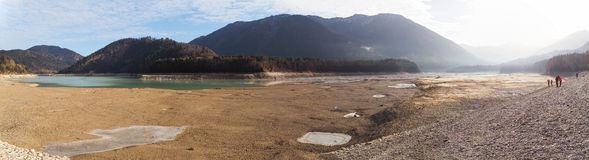 Panorama of dried out lake - Sylvenstein, south of Bavaria, Germany Royalty Free Stock Image