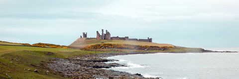 Panorama of Dunstanburgh castle Stock Photos