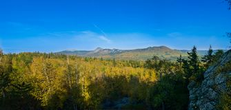 Panorama of early autumn from the height of Taganay mountain of. The Ural range Stock Photo
