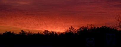 The early sky glows orange at sunrise in Michigan stock photo