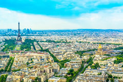 Panorama Eiffel Tower in Paris from a height on a sunny day with a blue sky. Royalty Free Stock Image