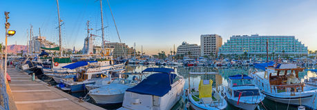 Panorama of the Eilat's harbor. The evening marina is especially beautiful, all the ships and yachts are bobbing on the waves, Eilat, Israel Royalty Free Stock Photos