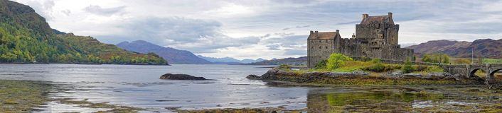 Panorama of Eilean Donan Castle and Loch. Eilean Donan is a small tidal island where three lochs meet, Loch Duich, Loch Long and Loch Alsh, in the western Royalty Free Stock Images