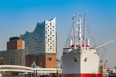 Elbphilharmonie in hamburg. Panorama of the elbphilharmonie in hamburg with a ship in front Stock Photography