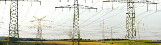 Panorama of electric power poles Stock Photography