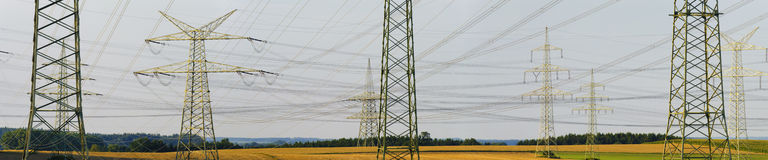Panorama of electric power poles Stock Photo