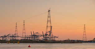 Panorama of electricity pylons against sunset sky Stock Photos