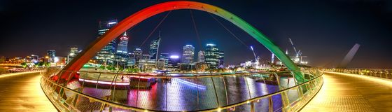 Panorama Elizabeth Quay Bridge. Panorama of coloful arcade and illuminated walkway of Elizabeth Quay Bridge by night at Elizabeth Quay Marina in Perth, Western Royalty Free Stock Image