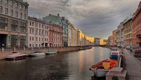 Moika river embankment in St. Petersburg at dawn. Panorama of the Embankment of the Moika river in Saint Petersburg early in the morning Royalty Free Stock Images