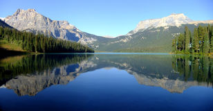 Panorama of Emerald Lake, Yoho National Park, British Columbia,. Panoramic view of mountains reflected in Emerald Lake, Yoho National Park, British Columbia Royalty Free Stock Photos