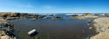 Panorama en verre de plage Photos stock
