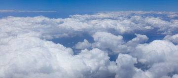 Panorama of endless white clouds covering land Royalty Free Stock Photo