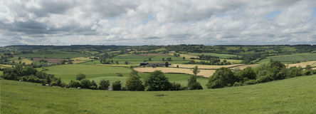Panorama of english midlands cotswolds landscape. Panorama of english midlands cotswolds with farm fields in the landscape Stock Photography