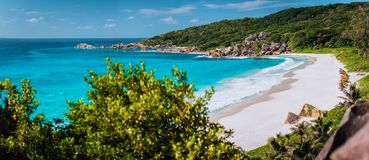 Panorama of epic Grand Anse Beach in La Digue island, Seychelles. White sand beach, big ocean waves and unique granite stock images