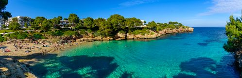 Panorama Of Esmeralda Beach. A panoramic view of Esmeralda beach in Mallorca island in summer season stock photo