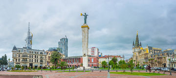 Panorama of the Europe Square in Batumi. The statue of Medea with the golden fleece topped the high stone column in center of the Europe Square, surrounded by Stock Photography