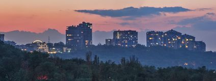 Panorama of the evening city at sunset. stock photography