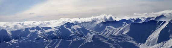 Panorama of evening mountains in clouds Stock Photography