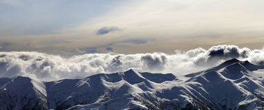 Panorama of evening mountains in clouds Stock Photos